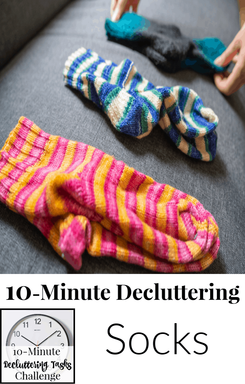 3 pairs of socks laid flat on table with clock image overlay reading 10-Minute Decluttering Socks