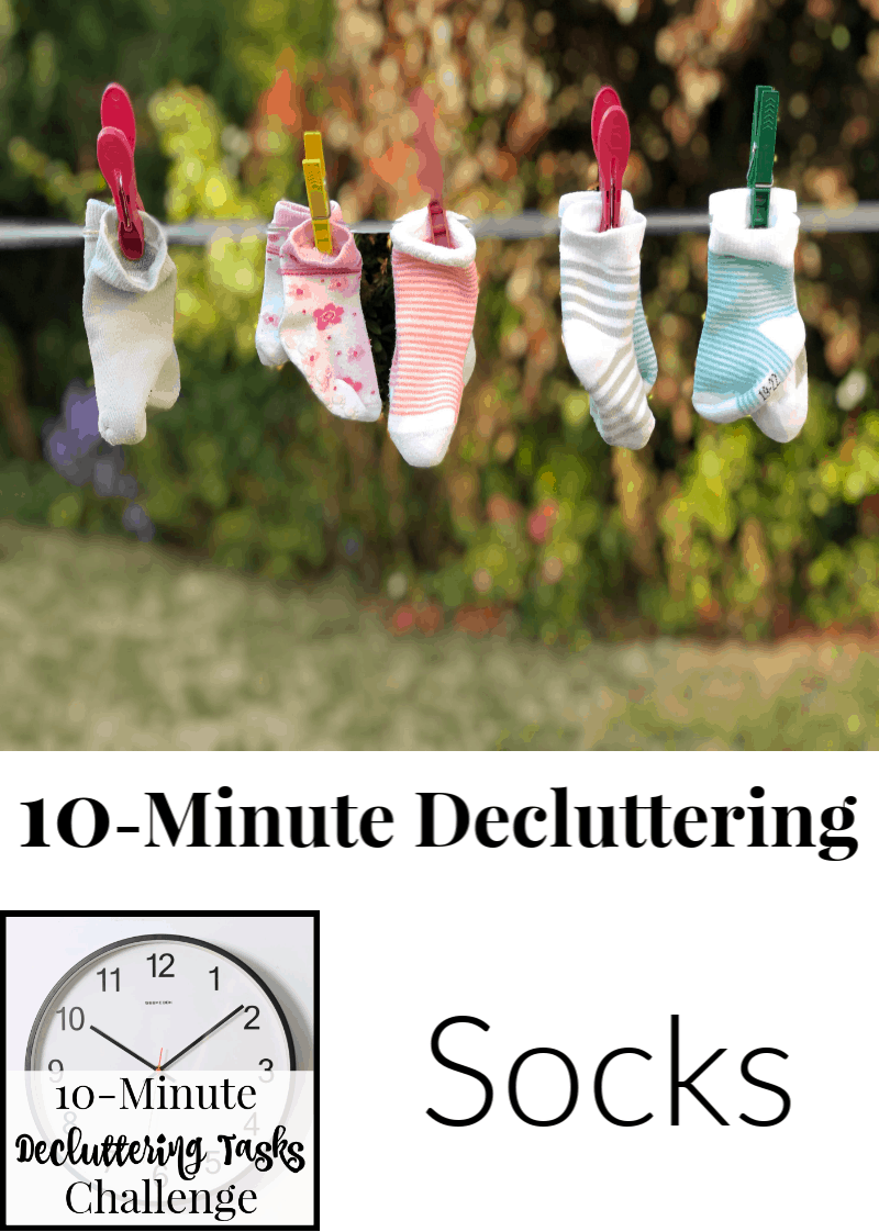 5 pairs of children's socks clothespinned to clothesline with text title reading 10-Minute Decluttering Socks
