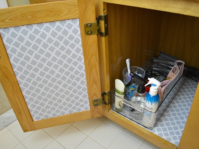 Bathroom cabinet organized with clear containers