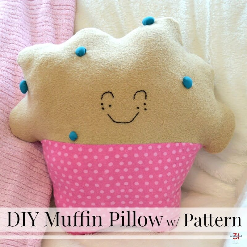 Blueberry muffin pillow with pink polka dot muffin paper and smiling