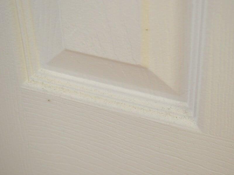 6 Panel door close-up of dust.