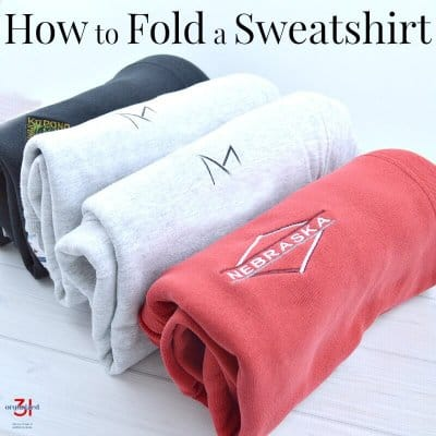 4 file folded sweatshirts standing up in row