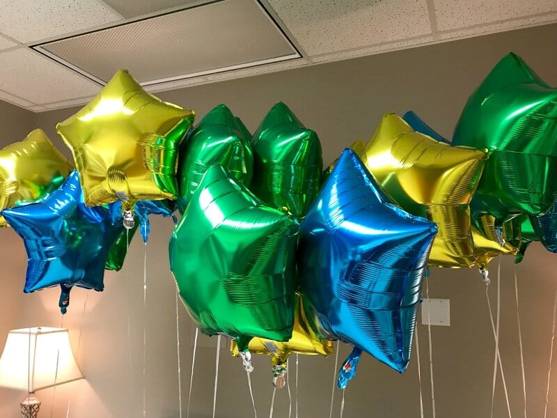 brightly colored star balloons in a hospital room