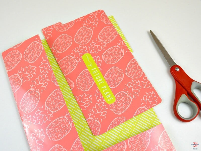 tabbed divider cut from file folder with red scissors nearby