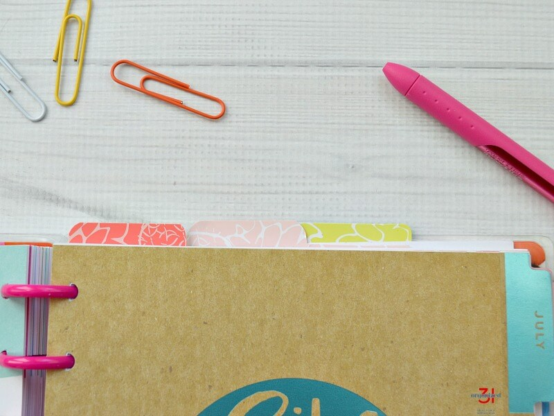 3 top tab dividers in Happy Planner with paperclips and pen nearby