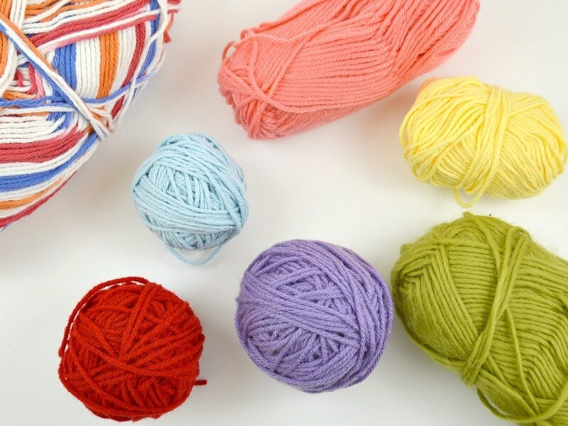 Overhead view of brightly colored balls of yarn