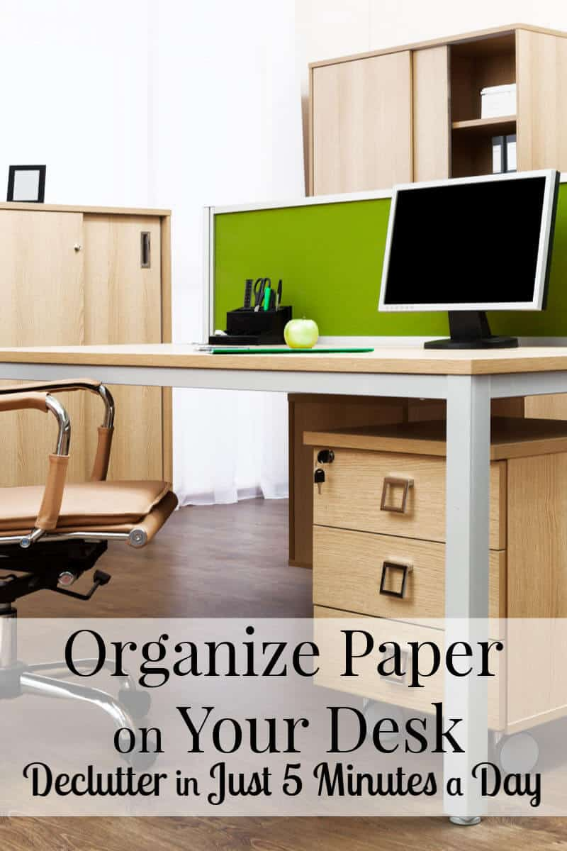 sleek, modern and organized desk in cubical with title text reading Organize Paper on Your Desk - Declutter in Just 5 Minutes a Day