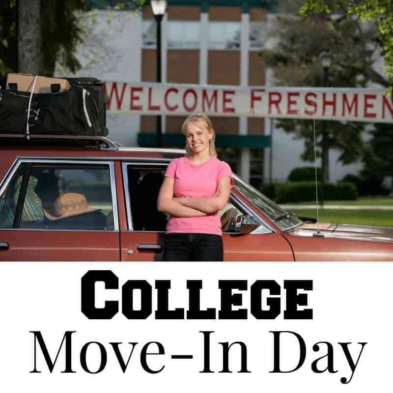 "smiling girl standing in front of packed car with big ""welcome freshman"" sign behind her"