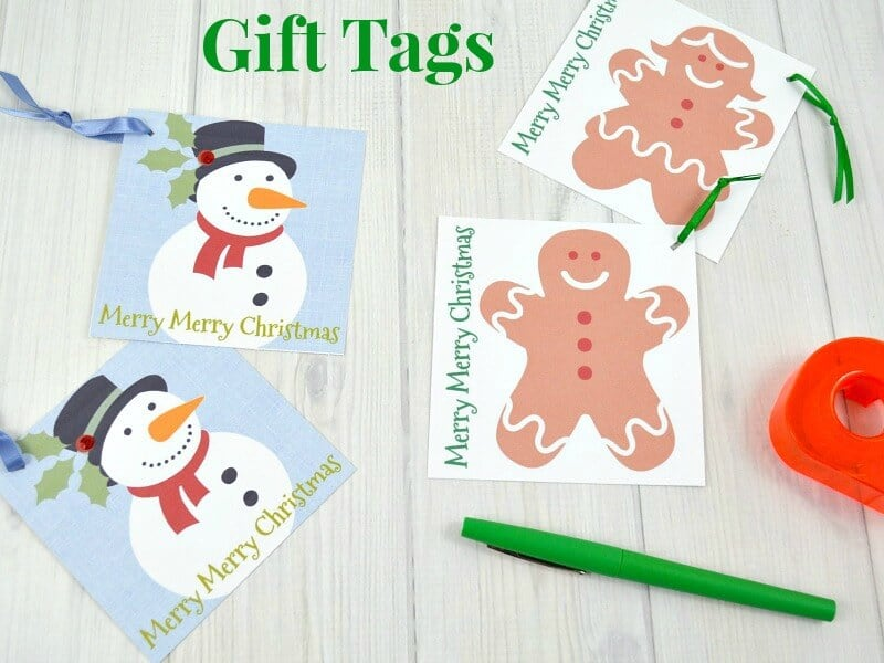 2 snowman gift tags with blue ribbon and 2 gingerbread people gift tags and green marker nearby with title text reading Gift Tags