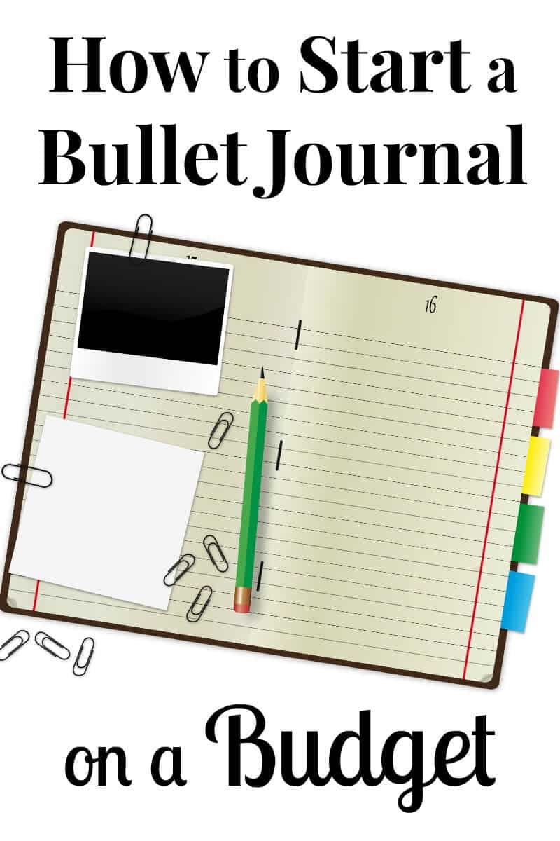 If you are thinking of starting a bullet journal, you should know that it is possible to start a bullet journal on a budget. - journal with paper clips, green pencil and colorful tabs