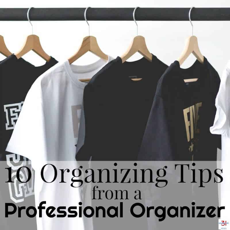 You can organize anything with these 10 simple organizing tips from a professional organizer. An organized home is a happy and calm home. - Black t-shirts and one white one hanging on wood hangers on a rod.