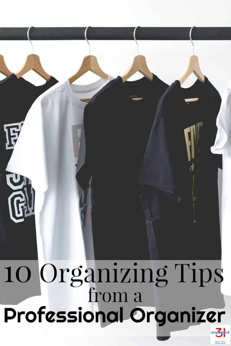 "black and white t-shirts on wood hangers hanging neatly on black bar with text overlay saying ""10 Organizing tips from a professional organizer"""