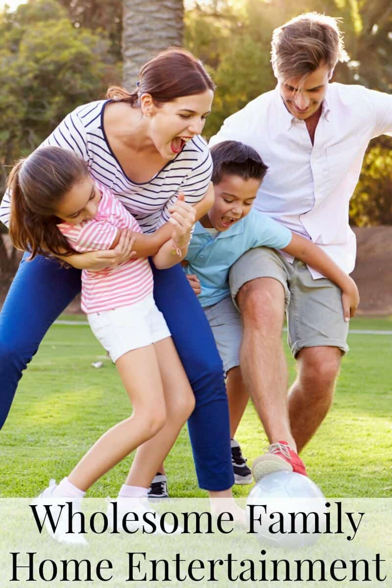 Family of 4 playing soccer together outside and laughing with title text overlay reading Wholesome Family Home Entertainment