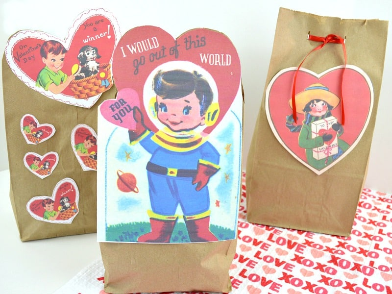 close up of three paper bags with vintage Valentine's images
