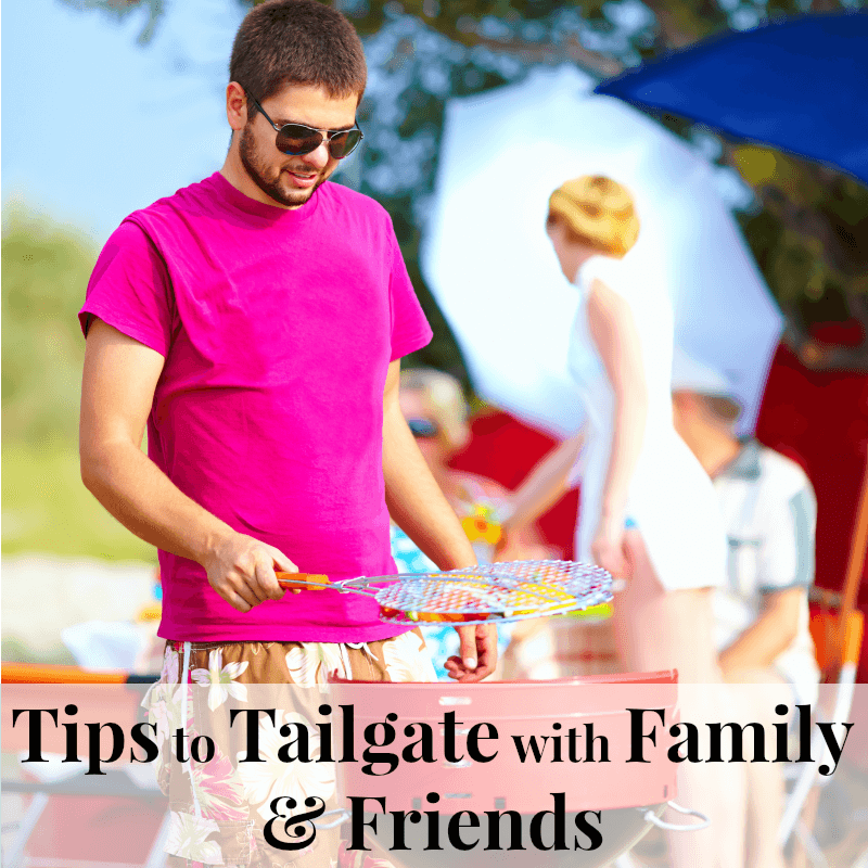 Man in pink shirt grilling out at tailgate party