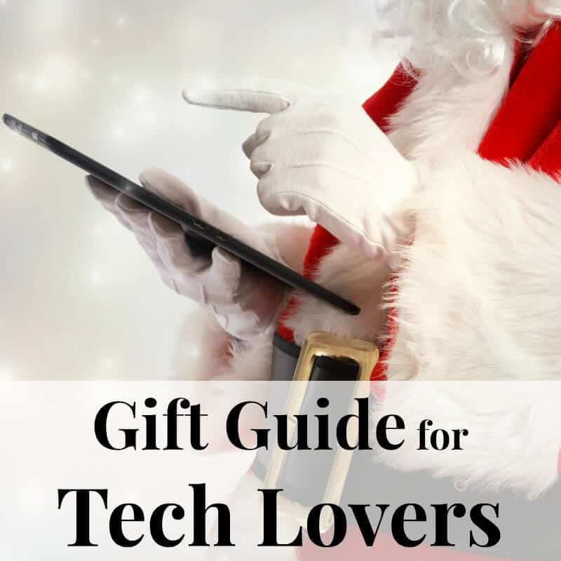 Santa holding an electronic tablet - A complete gift guide for the tech lover - 10 gift ideas they'll love for family and friends of all ages.