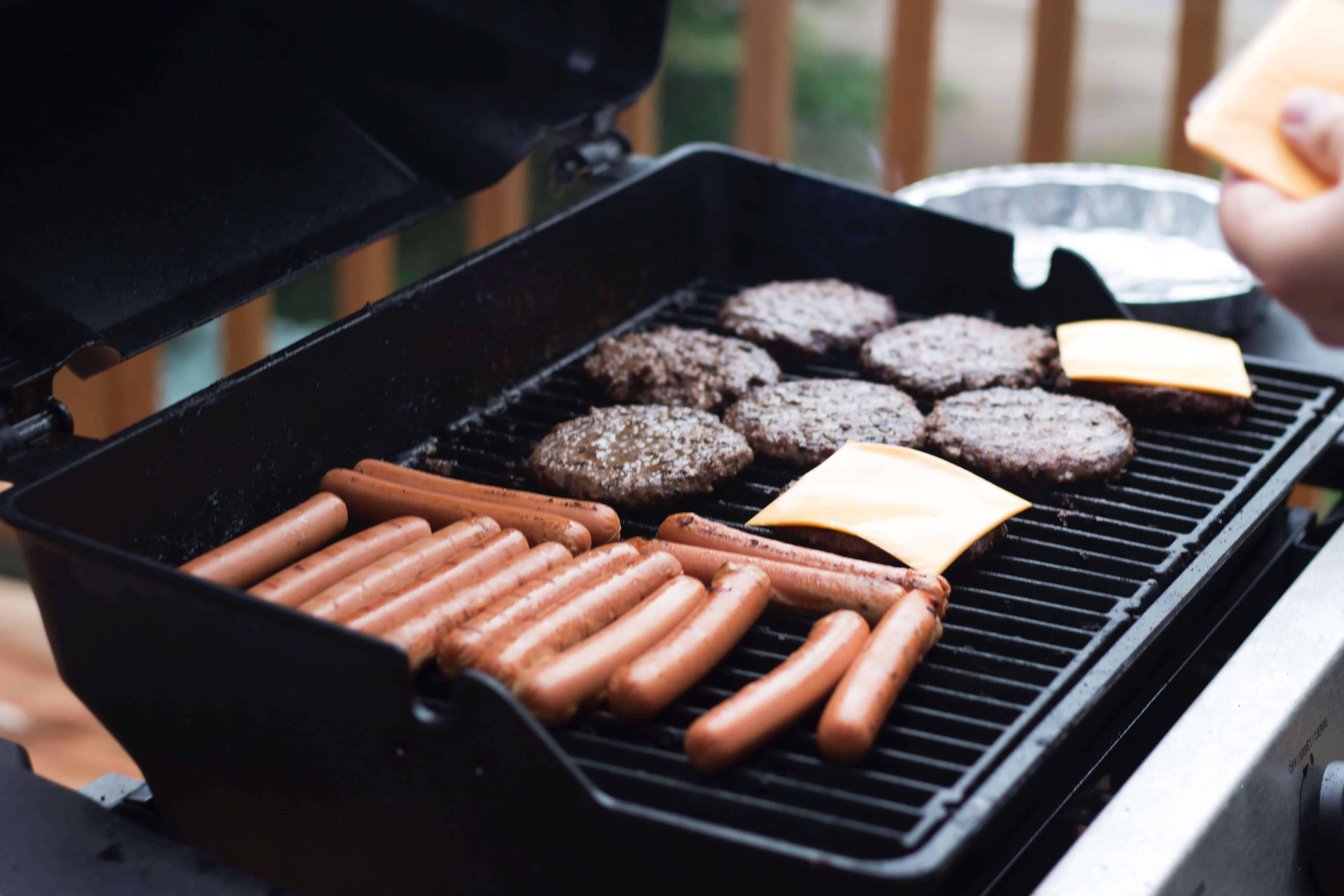 Hot dogs and hamburgers on grill