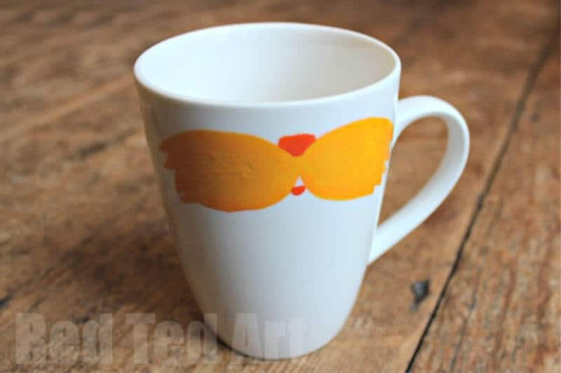 The Lorax mustache painted on white coffee cup