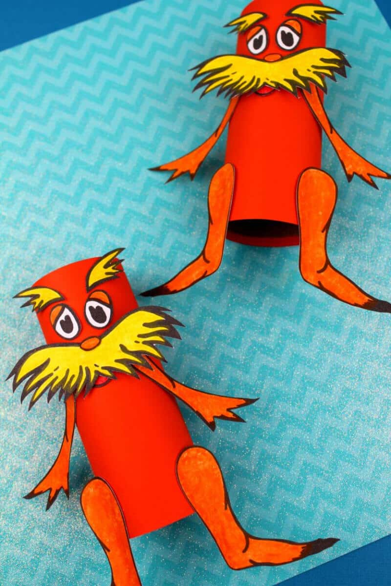 red and yellow Lorax craft on toilet paper rolls