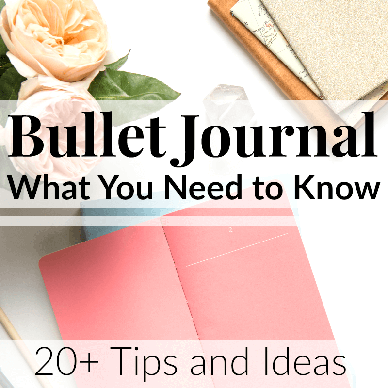 Pink journal cover with other journals stacked nearby with text overlay reading Bullet Journal What You Need to Know 20+ Tips and Ideas