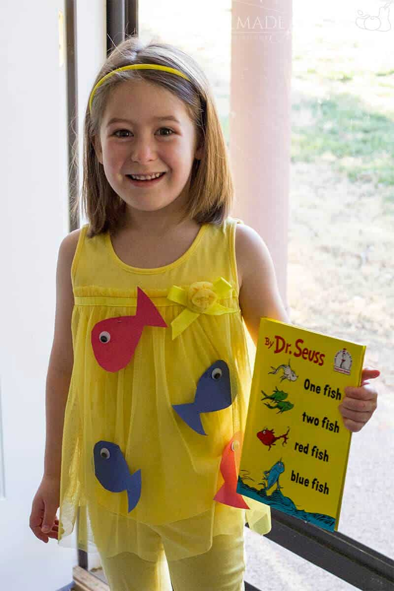 smiling girl in yellow Red Fish Blue Fish costume