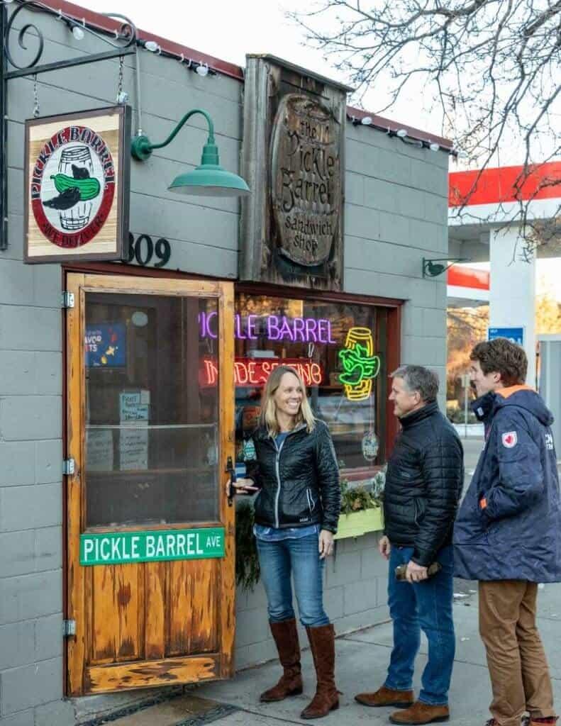 Family entering door of college town restaurant.