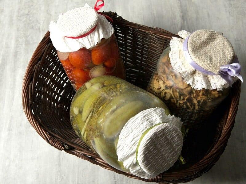 3 jars of food in a basket