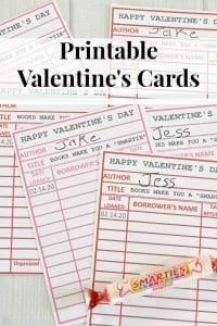 printable library cards for Valentine's day and smarties candy with title text overlay reading Printable Valentine's Cards
