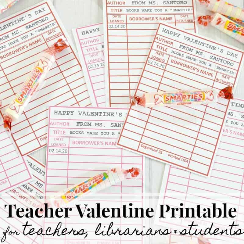 Red and pink library card Valentine's with candy scattered on table with text overlay