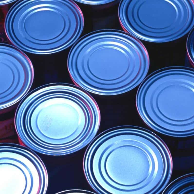 These tips for an organized pantry will reduce the stress in your day, save you time and money and encourage independence in your family. - tops of tin food cans