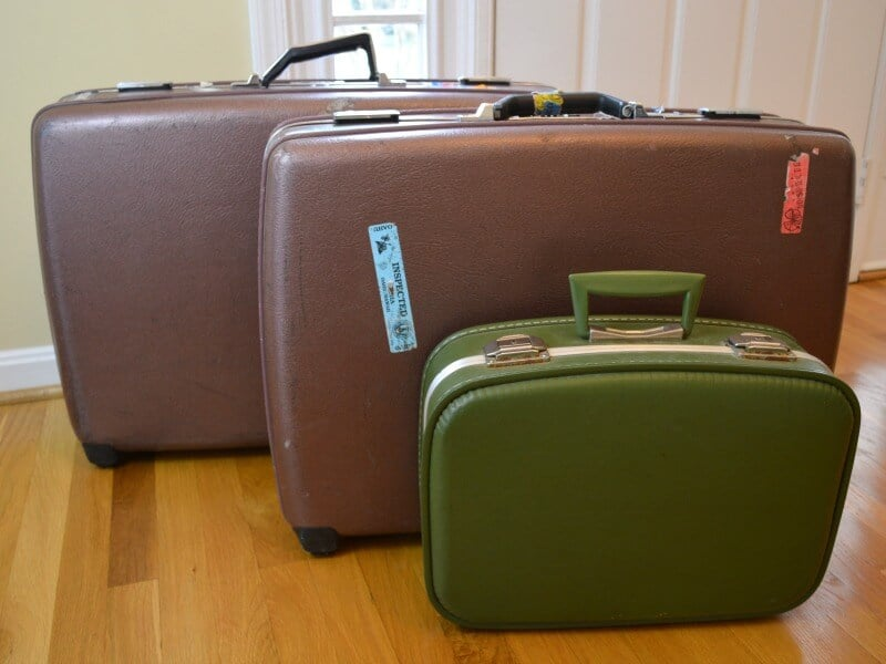 3 suitcases sitting next to a front door