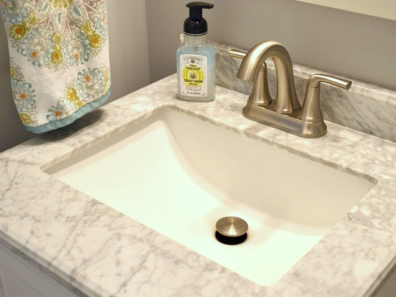 marble bathroom sink with bottle of soap