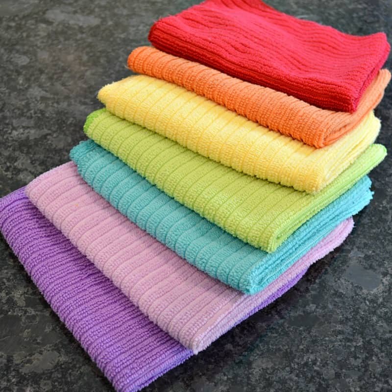 Stack of 7 rainbow colored cleaning cloths
