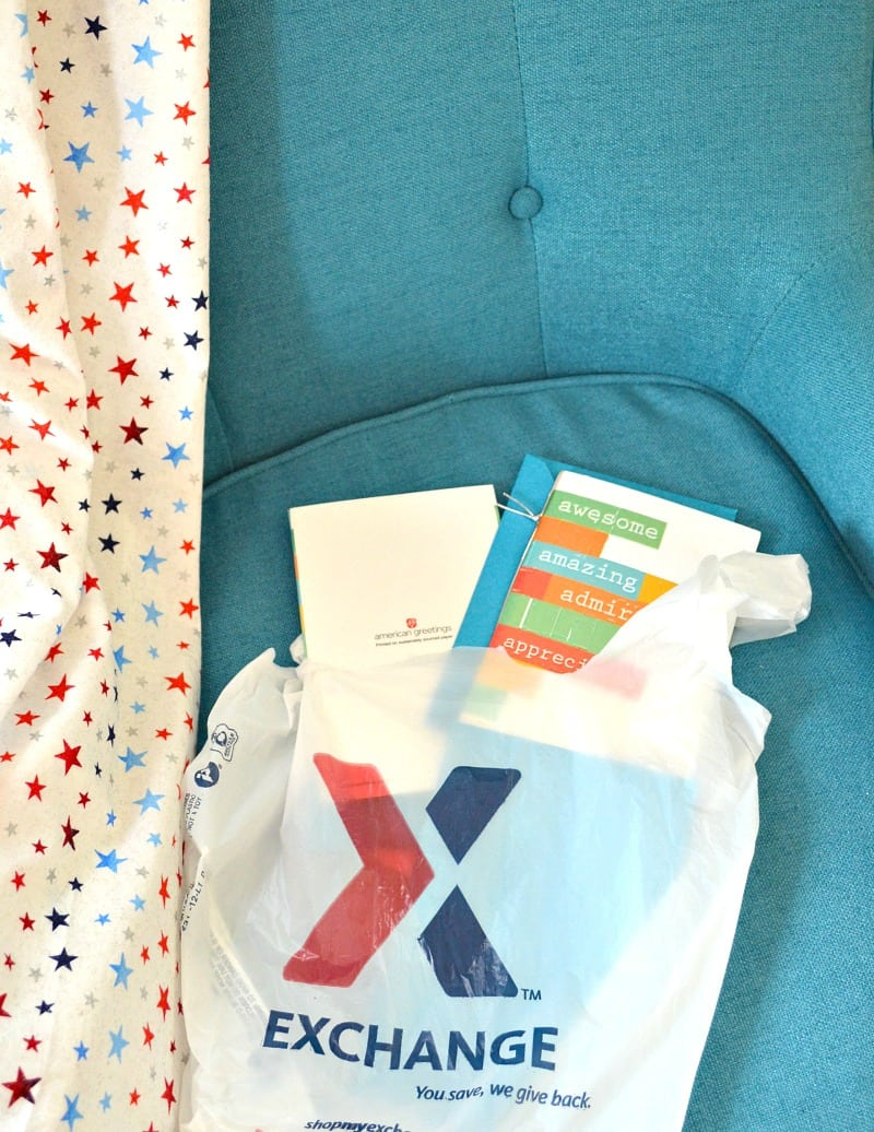 shopping bag with cards on blue chair with star blanket
