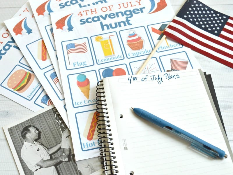 4th of July scavenger hunt form, flag, notebook and pen