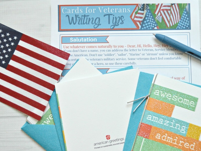 tips for writing cards to veterans with cards on top and flag