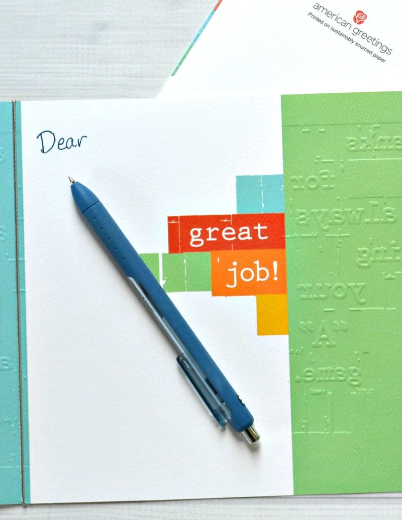 "card with ""dear"" written and pen"