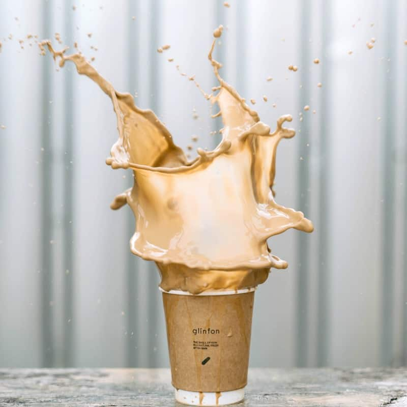 Coffee cup with coffee splashing out
