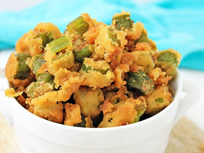close up of crispy fried okra in white bowl