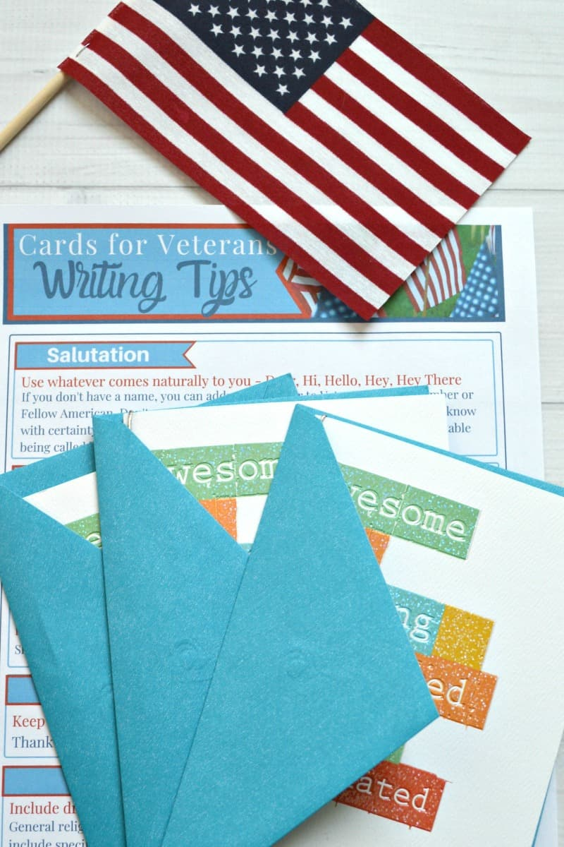 three cards stacked on top of writing tips form with flag