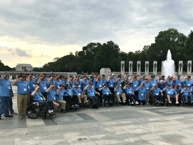 group of veterans in front of WWII memorial