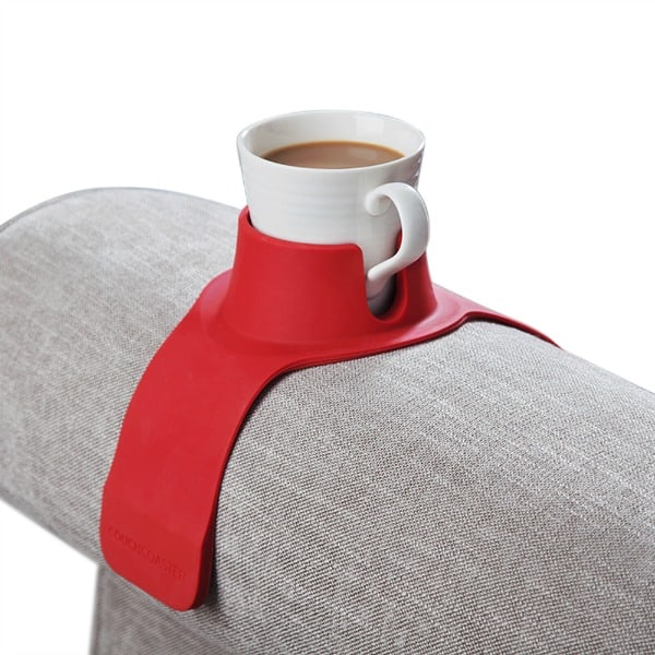 red cup holder with white coffee cup on grey couch arm