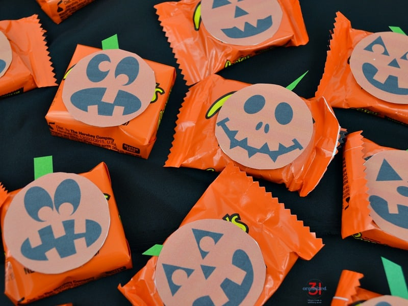 candy with free printable jack o'lantern faces added as decoration