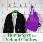 School clothes for girl on hanger, on white wall background