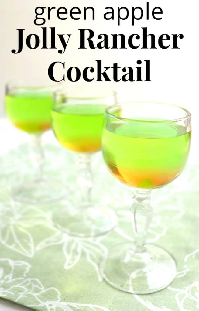 3 glasses in angled row with orange and bright green colored drinks with title text reading green apple Jolly Rancher Cocktail