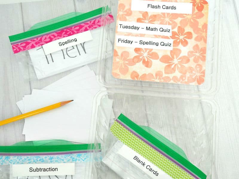 Box with quiz schedule and zippered backs of school flashcards