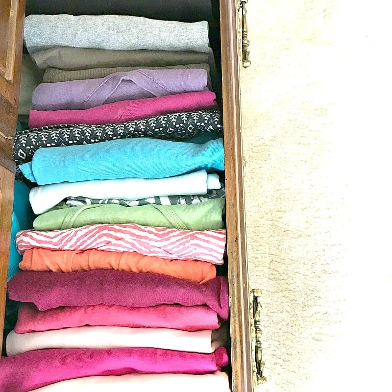 colorful t-shirts folded and organized in drawer