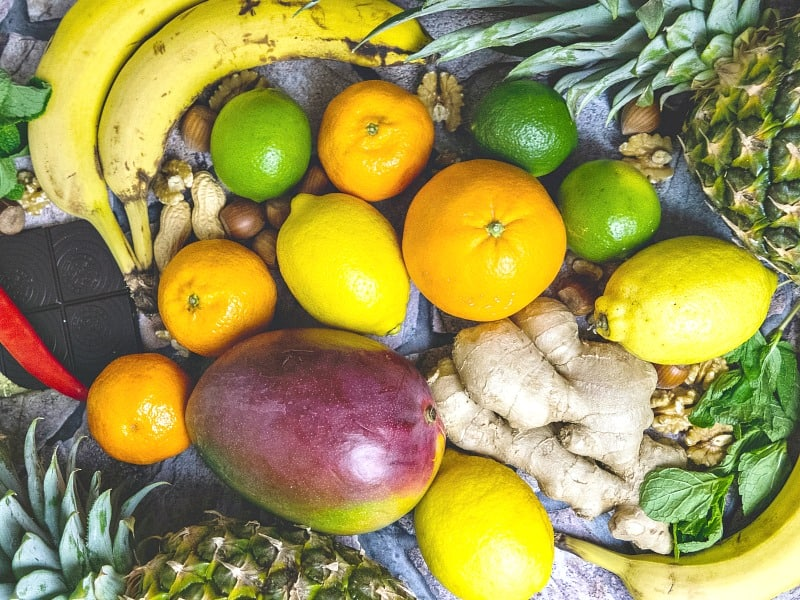 Colorful fruits, nuts and herbs