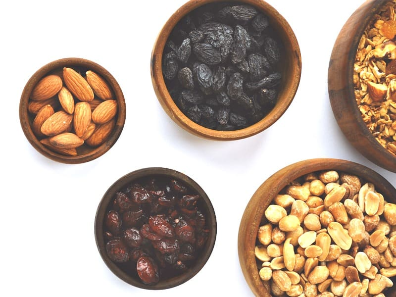 5 bowls with assorted nuts and dried fruit