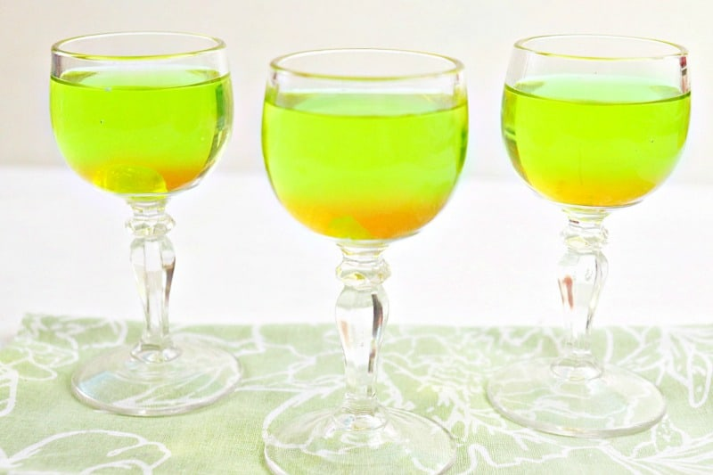 3 glasses with bright green drink